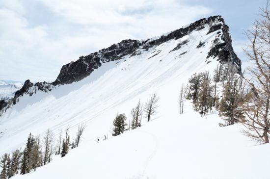 Chris skis below the iconic high point on Printz Ridge above Sear's Lake