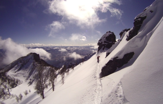 A skier finds their line from the summit of the Crown Jewel
